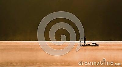 One Angler Fishing on A Lake