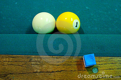 One ball touching cue ball on pool table