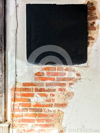 Free One Blank Chalkboard And Brick Wall Stock Images - 129977294