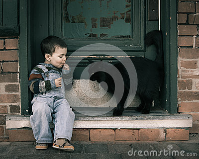 One boy and a cat