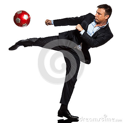 One business man playing kicking soccer ball