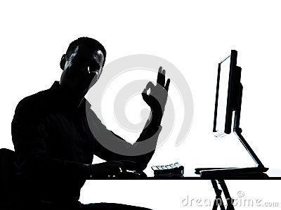 One business man silhouette computer computing ok gesture