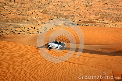 One car in wild gold color desert, dune background
