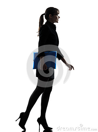Business woman  holding folders files walking silhouette