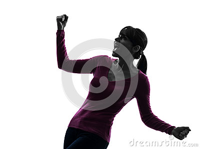 Woman arms outstretched screaming happy silhouette