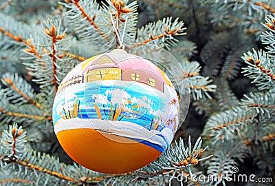 One christmas ball handing on a tree.