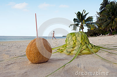 One coconut and sun hat on the sandy sea shore