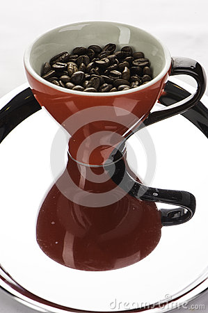 One coffe cups with beans