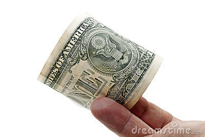 One dollar banknote in a fingers