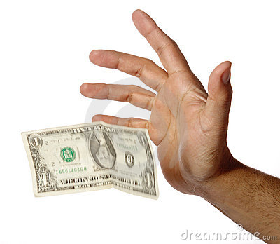 One dollar falling from a human hand