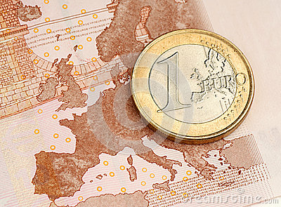 One Euro Coin on Euro Banknote