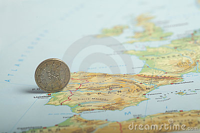 One euro coin on a European map (Portugal)