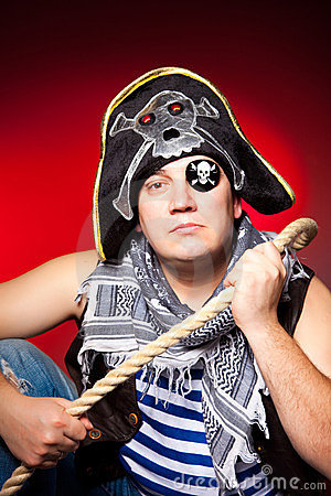 One-eyed pirate with a cocked hat and a rope