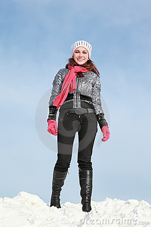 One girl stands in winter on snow and smile