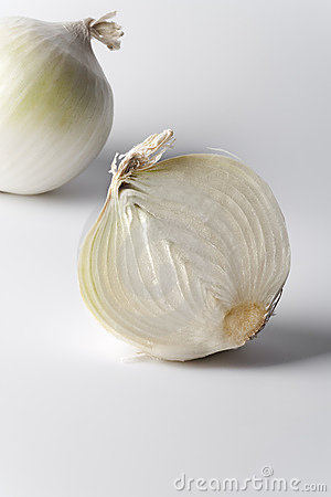 One and a half white onion on white background