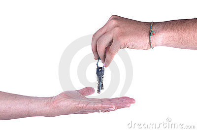 One hand giving keys to other isolated