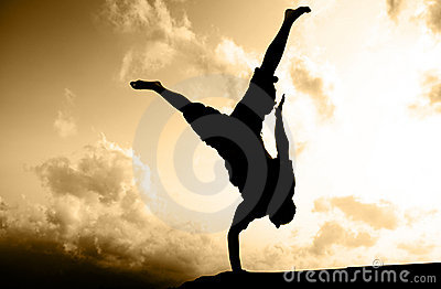 One hand standing silhouette