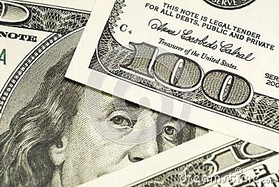One hundred dollar bills background