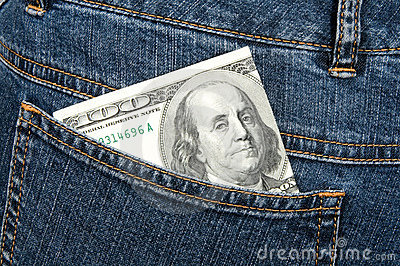 One hundred dollars banknote in hip-pocket of jeans