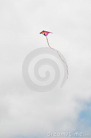 One Kite Flying over a Cloudy Sky