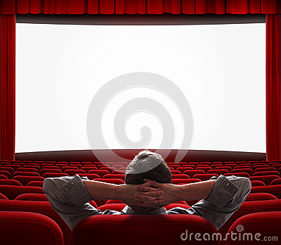 One man alone in empty cinema hall