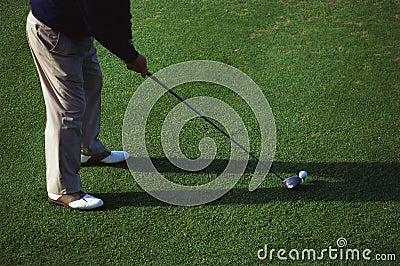 One man golfing