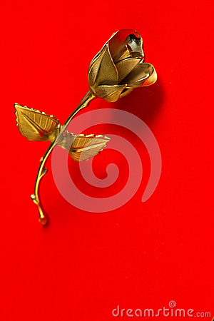 Free One Metal Rose On A Red Background For Holiday Greetings Stock Photos - 83352353