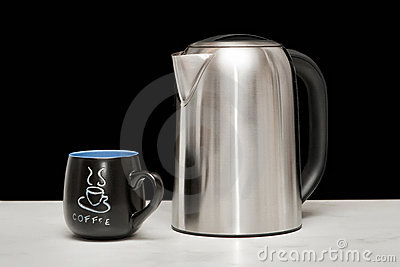 One mettal kettle and coffee cup