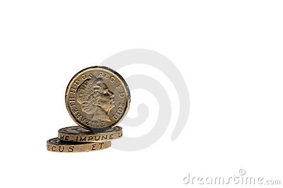 One pound coins on the edge isolated