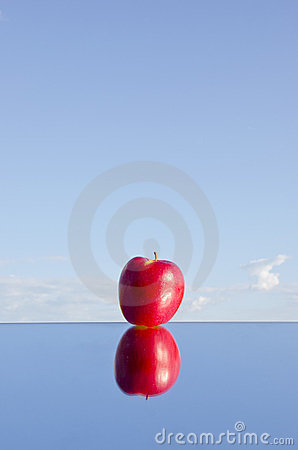 Free One Red Apple On Mirror And Sky Royalty Free Stock Image - 23712806