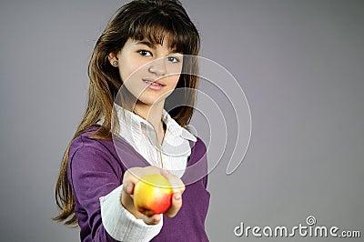 One school girl offering healthy fruit