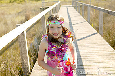 One teen girl running outdoor at the park
