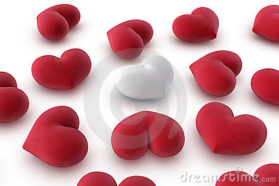 One white heart among several red