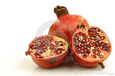 One whole pomegranate and two halves