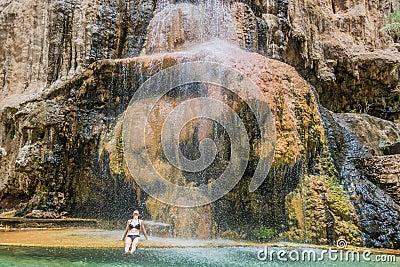 One woman bathing ma in hot springs waterfall jordan