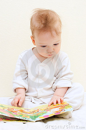 One year baby boy reads children s book