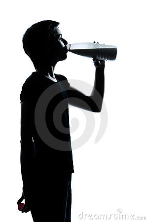 One young teenager girl drinking milk silhouette