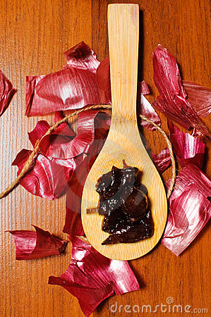 Onion jam on a wooden spoon