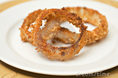 Onion rings on white plate