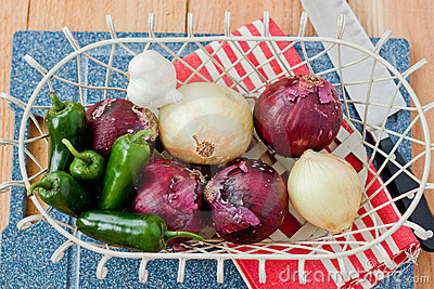 Onions and peppers in a basket