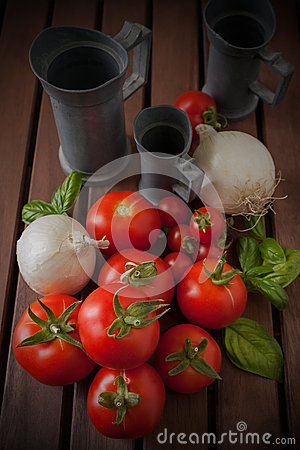 Onions and Tomatoes on wood table
