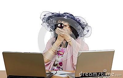 Online acting studio owner applying powder on her face