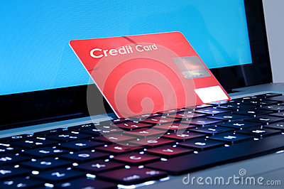 Online shopping, laptop and credit card close up