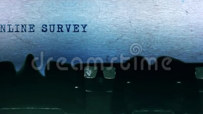 Online survey words Typing on a sheet of paper with old vintage typewriter. stock video