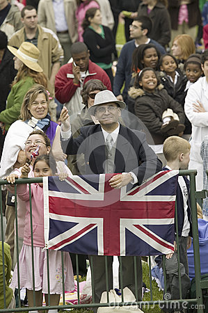 Onlooker displaying Union Jack British Flag Editorial Photography