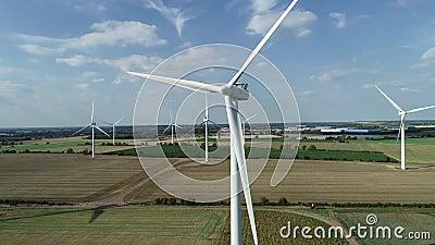 Onshore wind farm green fields, 4k stock footage