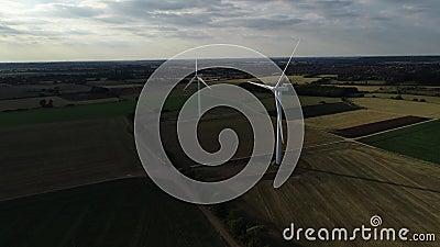 Onshore wind turbine farm at Sunset stock video footage
