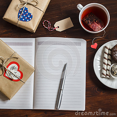 Free Open A Clean Blank Notepad, Valentines Day Homemade Gifts, A Cup Of Tea And Sweets On Wooden Brown Table. Stock Photos - 66326553