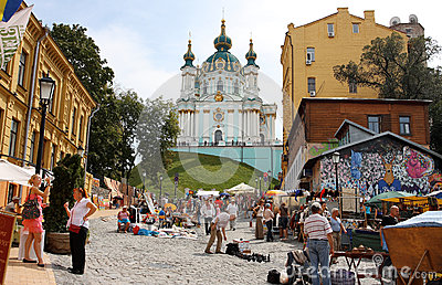 Open air market against the church Editorial Stock Image