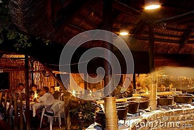 Open air safari restaurant interior at night